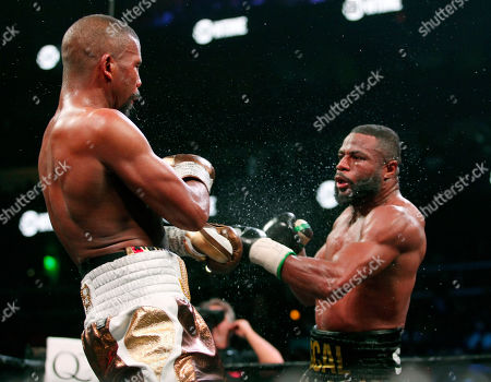 Badou Jack, left, battles with Jean Pascal in the WBA and WBC secondary titles at a light heavyweight match in the eighth round n Atlanta