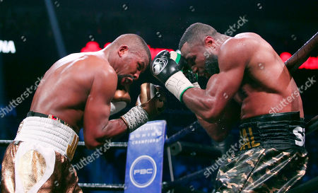 Stock Photo of Badou Jack, left, battles with Jean Pascal in the WBA and WBC secondary titles at a light heavyweight match in the eighth round n Atlanta