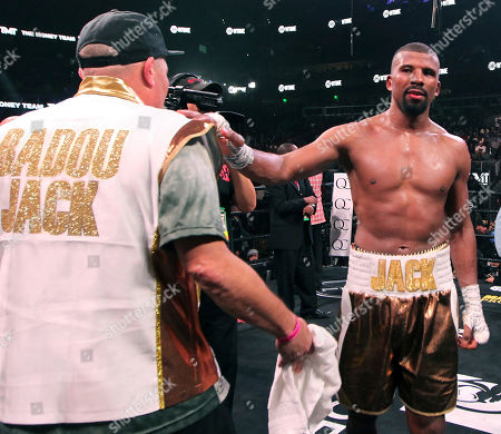 Badou Jack, right, stands with a corner man as he waits results in his fight with Jean Pascal, not seen, in the WBA and WBC secondary titles at a light heavyweight match in Atlanta. Pascal won in a split decision