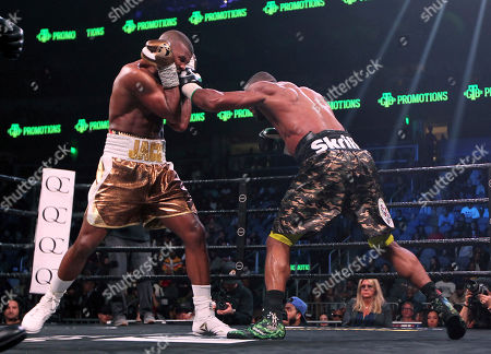 Badou Jack, left, battles with Jean Pascal in the WBA and WBC secondary titles at a light heavyweight match in the sixth round in Atlanta
