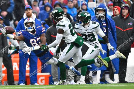 New York Jets' Marcus Maye (20) defends Buffalo Bills wide receiver Duke Williams (82) during the first half of an NFL football game in Orchard Park, N.Y