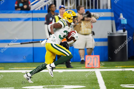 Green Bay Packers running back Tyler Ervin (32) runs the ball against the Detroit Lions during an NFL football game at Ford Field in Detroit