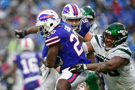 New York Jets defensive tackle Quinnen Williams (95) tackles Buffalo Bills' Frank Gore (20) during the first half of an NFL football game in Orchard Park, N.Y