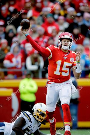 Melvin Ingram III, Patrick Mahomes. Kansas City Chiefs quarterback Patrick Mahomes (15) throws a pass in front of Los Angeles Chargers defensive end Melvin Ingram III (54) during the first half of an NFL football game in Kansas City, Mo