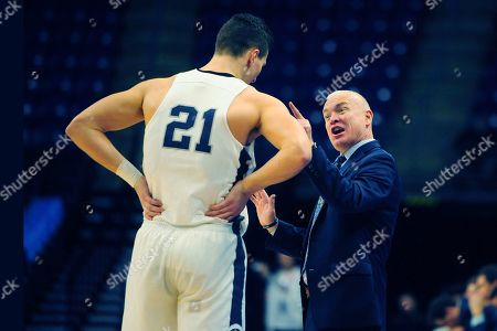 Penn State coach Pat Chambers confers with John Harrar (21) during second half action of an NCAA college basketball game, in State College, Pa