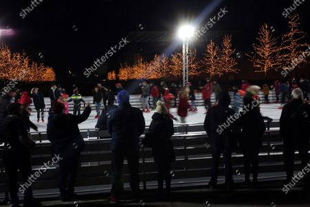 Stock Photo of People skate in an ice skating rink decorated for Christmas at the Stavros Niarchos Foundation Cultural Centre in Athens, Greece, 29 December 2019.