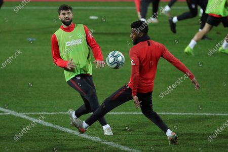 Stock Image of Atletico Madrid's players Felipe Augusto (L) and Thomas Lemar attend the first training session of the team after the Christmas break at the Wanda Sports City Complex in Majadahonda, Madrid, Spain, 29 December 2019.
