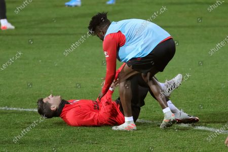 Atletico Madrid's players Alvaro Morata (L) and Thomas Partey attend the first training session of the team after the Christmas break at the Wanda Sports City Complex in Majadahonda, Madrid, Spain, 29 December 2019.