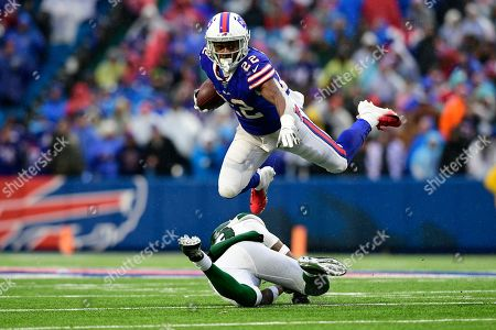 Stock Photo of Buffalo Bills running back T.J. Yeldon (22) hurdles New York Jets strong safety Jamal Adams (33) during the second half of an NFL football game in Orchard Park, N.Y