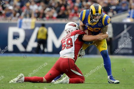 Los Angeles Rams tight end Tyler Higbee is tackled by Arizona Cardinals linebacker Joe Walker during second half of an NFL football game, in Los Angeles