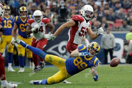Arizona Cardinals linebacker Joe Walker breaks up a pass intended for Los Angeles Rams tight end Tyler Higbee during second half of an NFL football game, in Los Angeles