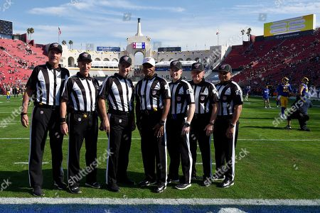 Stock Photo of From left, side judge Dave Meslow (118), back judge Tony Steratore (112), umpire Carl Paganelli (124), referee Jerome Boger (23), side judge Jonah Monroe (120), line judge Rusty Baynes (59), head linesman Wayne Mackie (106), pose before an NFL football game, in Los Angeles