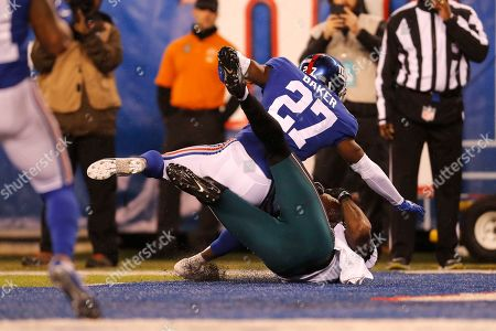 Philadelphia Eagles tight end Josh Perkins (81) scores a touchdown in front of New York Giants cornerback Deandre Baker (27) in the first half of an NFL football game, in East Rutherford, N.J