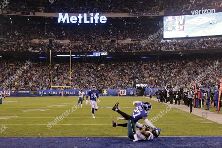 Stock Image of Philadelphia Eagles tight end Josh Perkins (81) scores a touchdown in front of New York Giants cornerback Deandre Baker (27) in the first half of an NFL football game, in East Rutherford, N.J