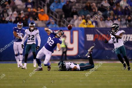 Stock Image of New York Giants tight end Kaden Smith (82) loses control of the ball in front of Philadelphia Eagles free safety Rodney McLeod (23) in the second half of an NFL football game, in East Rutherford, N.J
