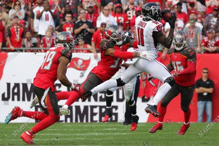 Atlanta Falcons wide receiver Julio Jones (11) catches the ball against Tampa Bay Buccaneers cornerback Carlton Davis (33) during the NFL game between the Atlanta Falcons and the Tampa Bay Buccaneers held at Raymond James Stadium in Tampa, Florida. Andrew J
