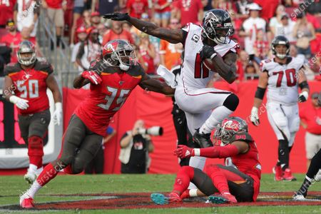 Atlanta Falcons wide receiver Julio Jones (11) catches the ball against Tampa Bay Buccaneers cornerback Carlton Davis (33) and Tampa Bay Buccaneers cornerback Jamel Dean (35) during the NFL game between the Atlanta Falcons and the Tampa Bay Buccaneers held at Raymond James Stadium in Tampa, Florida. Andrew J