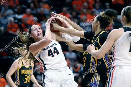 Oregon State's Taylor Jones (44) fights with Cal State Bakersfield's Miracle Saxon (23) and Jayden Eggleston (10) for possession of a rebound during the first half of an NCAA college basketball game in Corvallis, Ore
