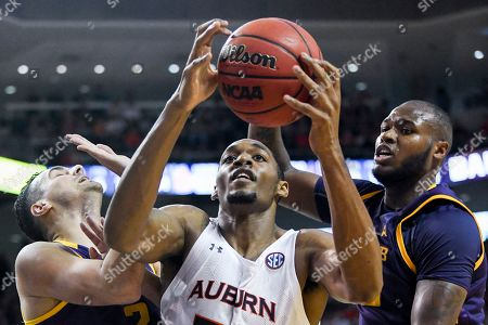 Auburn center Austin Wiley (50) snags a rebound over Lipscomb guard Andrew Fleming (2) and center Ahsan Asadullah (23) during the second half of an NCAA college basketball game, in Auburn, Ala