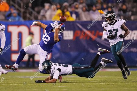 Stock Picture of New York Giants tight end Kaden Smith (82) loses control of the ball in front of Philadelphia Eagles free safety Rodney McLeod (23) in the second half of an NFL football game, in East Rutherford, N.J