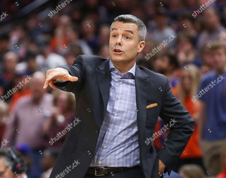 Virginia head coach Tony Bennett reacts to a call during an NCAA college basketball game against Navy in Charlottesville, Va