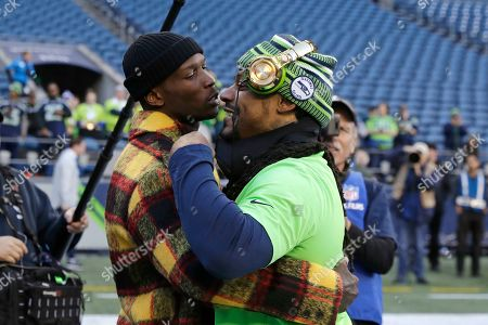 Stock Picture of Marshawn Lynch, Chad Ochocinco. Seattle Seahawks' Marshawn Lynch, right, embraces former NFL player Chad Ochocinco before an NFL football game against the San Francisco 49ers, in Seattle