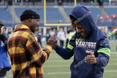 Seattle Seahawks' Shaquill Griffin greets former NFL player Chad Ochocinco before an NFL football game against the San Francisco 49ers an NFL football game, in Seattle