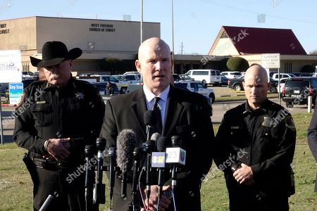Stock Image of Texas Department of Public Safety regional director Jeff Williams speaks during a news conference, as Tarrant County Sheriff Bill Waybourn, left, and White Settlement Police Chief J.P. Bevering, right, stand behind him, in front of West Freeway Church of Christ, in White Settlement, Texas. Police say congregants shot and killed a man who opened fire at the church