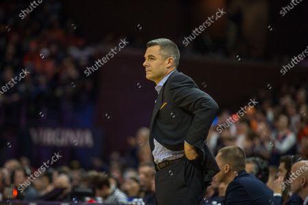 Virginia Cavaliers head coach Tony Bennett watches from the sideline during NCAA basketball action between the Navy Midshipmen and the Virginia Cavaliers at John Paul Jones Arena Charlottesville, VA