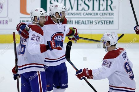 Shea Weber, Jeff Petry, Tomas Tatar. Montreal Canadiens defenseman Shea Weber, center, celebrates with defenseman Jeff Petry (26) and left wing Tomas Tatar (90) after scoring during the third period of an NHL hockey game against the Florida Panthers, in Sunrise, Fla