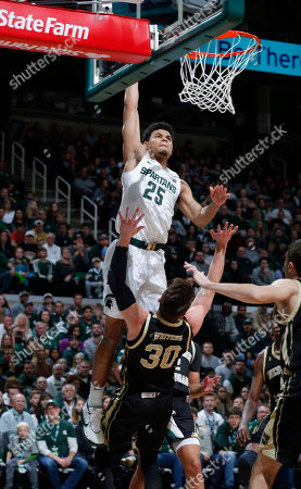 Michigan State's Malik Hall (25) goes up for a dunk over Western Michigan's Jason Whitens (30) during the first half of an NCAA college basketball game, in East Lansing, Mich