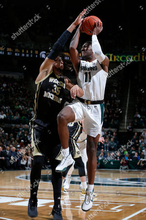 Michigan State's Aaron Henry, right, goes to the basket against Western Michigan's Brandon Johnson (35) during the second half of an NCAA college basketball game, in East Lansing, Mich. Michigan State won 95-62