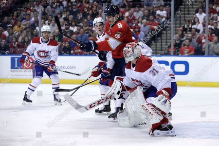 Montreal Canadiens goaltender Carey Price (31) defends the goal as Florida Panthers center Brian Boyle (9) waits for the puck during the first period of an NHL hockey game, in Sunrise, Fla