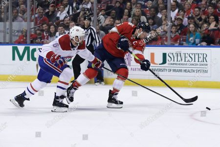 Montreal Canadiens defenseman Shea Weber (6) and Florida Panthers center Aleksander Barkov (16) chase the puck during the first period of an NHL hockey game, in Sunrise, Fla