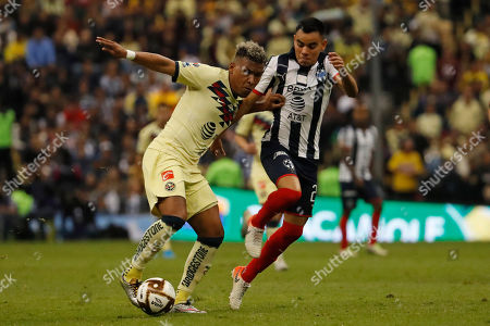 America's Roger Martinez, left, and Monterrey's Carlos Rodriguez fight for the ball during their Mexican soccer league second-leg final match at Azteca stadium in Mexico City