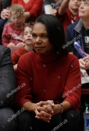 Condoleezza Rice watches during an NCAA college basketball game between Stanford and Kansas in Stanford, Calif