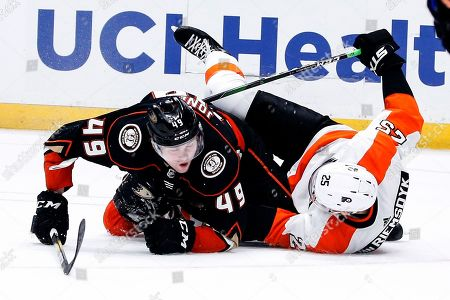 Anaheim Ducks forward Max Jones (49) collides with Philadelphia Flyers forward James van Riemsdyk (25) during the first period of an NHL hockey game, in Anaheim, Calif