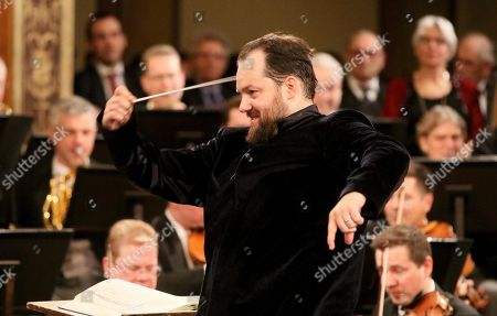 Latvian conductor Andris Nelsons conducts the Vienna Philharmonic Orchestra during a rehearsal for the traditional New Year's concert at the golden hall of Vienna's Musikverein, in Vienna, Austria