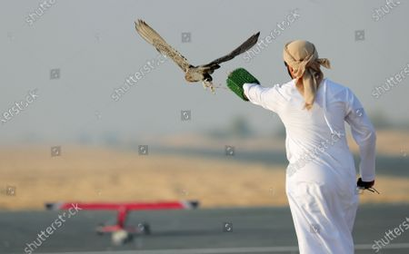 A man releases his gyrfalcon during the Fazza Championship for Falconry in Dubai, United Arab Emirates (UAE), 30 December 2019. The Fazza Championship for Falconry is sponsored by Dubai's Crown Prince Sheikh Hamdan bin Mohammed bin Rashid Al Maktoum. Falconry, locally known as 'kanas' is an integral part of the heritage of the UAE. The falconry tournaments run until the end of March 2020.