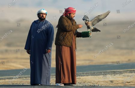 A man (R) prepares to release his gyrfalcon during the Fazza Championship for Falconry in Dubai, United Arab Emirates (UAE), 30 December 2019. The Fazza Championship for Falconry is sponsored by Dubai's Crown Prince Sheikh Hamdan bin Mohammed bin Rashid Al Maktoum. Falconry, locally known as 'kanas' is an integral part of the heritage of the UAE. The falconry tournaments run until the end of March 2020.