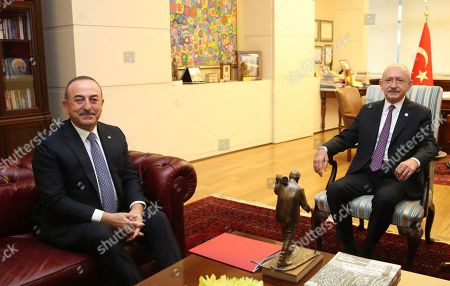 "Mevlut Cavusoglu, Kemal Kilicdaroglu. Turkey's Foreign Minister Mevlut Cavusoglu, left, and Kemal Kilicdaroglu, the leader of the main opposition Republican People's Party, CHP, during a meeting, in Ankara, Turkey, . The CHP said Monday it does not support the government's plans to deploy troops to Libya, saying the move would embroil Turkey in another conflict and make it a party to the ""shedding of Muslims"