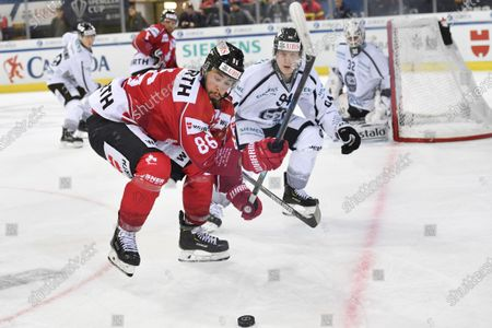 Team Canada's Josh Jooris (L) in action against Turku's Henrik Larsson during the game between Team Canada and TPS Turku, at the 93rd Spengler Cup ice hockey tournament in Davos, Switzerland, 30 December 2019.