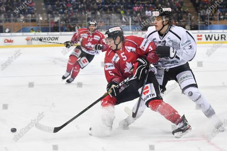 Team Canada's Ian Mitchell (L) versus Turku's Tony Sund during the game between Team Canada and TPS Turku, at the 93rd Spengler Cup ice hockey tournament in Davos, Switzerland, 30 December 2019.