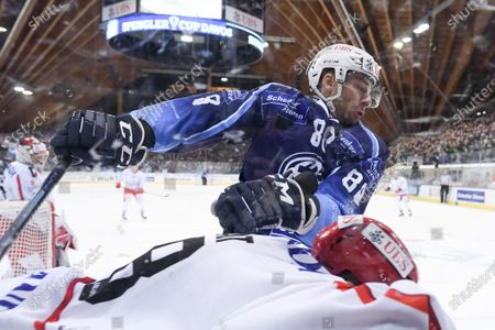 Ambri's Wojtek Wolski, up, versus Trinec's Martin Gernat, during the game between HC Ambri-Piotta and HC Ocelari Trinec at the 93th Spengler Cup ice hockey tournament in Davos, Switzerland, Monday, December 30, 2019.