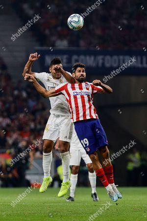 Diego Costa of Atletico de Madrid and Carlos Henrique Casimiro of Real Madrid