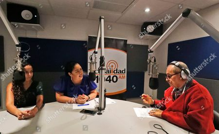 """Stock Photo of Julio Cesar Camacho, Cindy Polo, Luisana Perez. Julio Cesar Camacho, right, a Venezuelan journalist and one of the most popular Spanish-language radio hosts, speaks with Democratic Florida Rep. Cindy Polo, center, and Luisana Perez, left, Hispanic communications director, Florida Democratic Party, during his show """"Democracia al Dia,"""" or """"Democracy Up to Date,"""" in Doral, Fla. The Democratic party launched the weekly Spanish-language radio program and hired dozens of Spanish-speaking staffers to speak to the media and local organizations"""