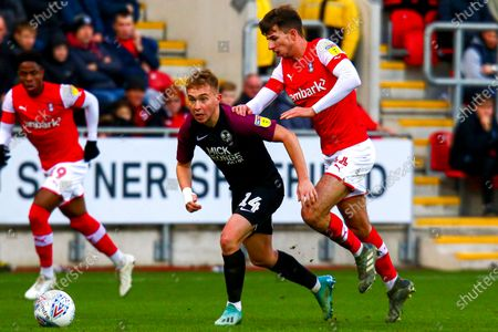 Dan Barlaser of Rotherham United chases down Louis Reed of Peterborough United