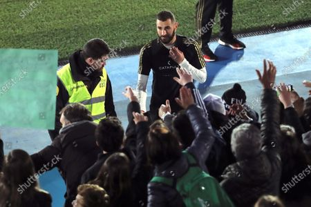 Real Madrid's Karim Benzema (C) greets supporters following the team's first training session after the Christmas break at the Alfredo Di Stefano sports complex in Madrid, Spain, 30 December 2019.