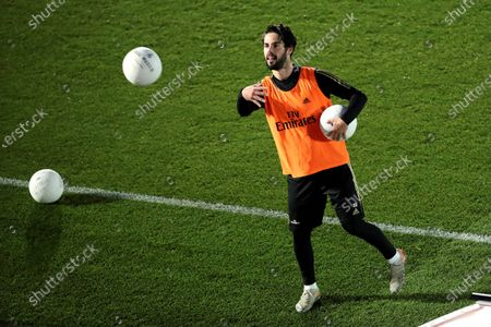 Real Madrid's Francisco Alarcon 'Isco' throws soccer balls to supporters following the team's first training session after the Christmas break at the Alfredo Di Stefano sports complex in Madrid, Spain, 30 December 2019.