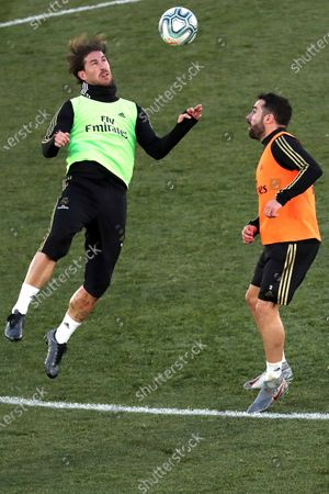 Real Madrid's Sergio Ramos (L) and Daniel Carvajal (R) attend the team's first training session after the Christmas recess at the Alfredo Di Stefano sports complex in Madrid, Spain, 30 December 2019.